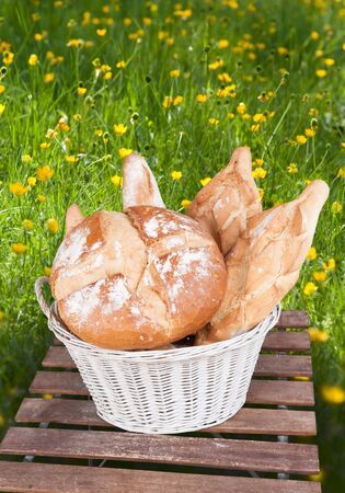 Basket with different types of bread on a rustic environment photo