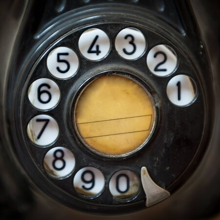 Close up shot of an old telephone dial photo
