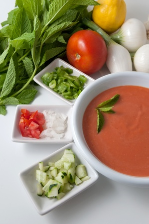 Gazpacho, cold tomato soup, with ingredients photo