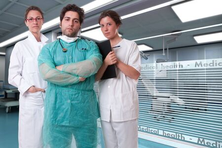 practitioner:  Medical staff team with a surgeon a practitioner and a nurse in a hospital