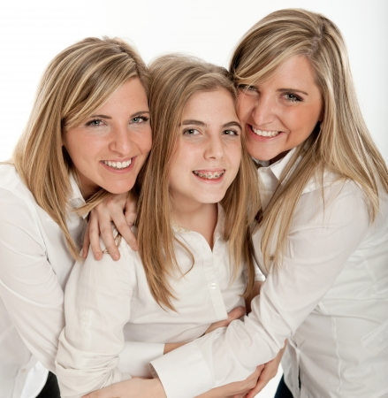 3 blond sisters of different ages smiling to the camera  photo