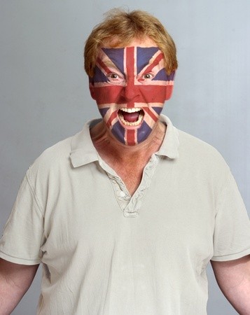 Hysterical supporter with the British flag painted on his face photo