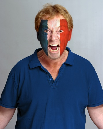 berserk: Hysterical supporter with the French flag painted on his face Stock Photo
