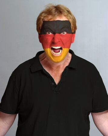 hysterical: Hysterical supporter with the German flag painted on his face Stock Photo