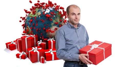 grateful:   Young man holding a present against a background of gift boxes and the Earth