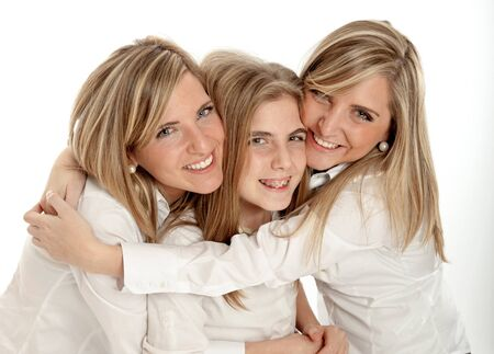3 blond sisters of different ages in a hug smiling to the camera  photo