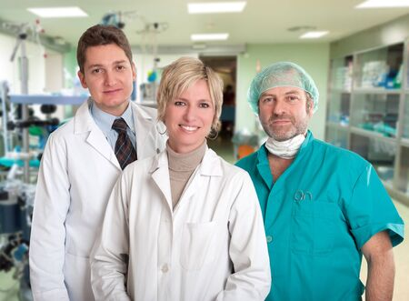 operating room: Smiling medical team in an operating room