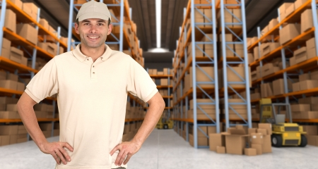 delivery service: Deliveryman carrying a parcel in a distribution warehouse