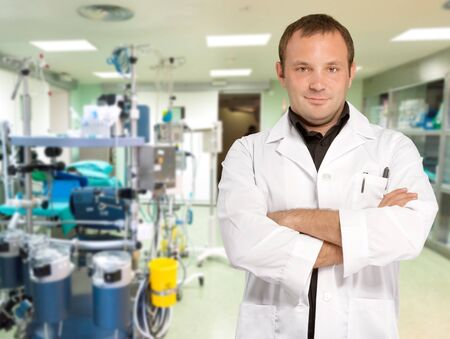 Young  doctor standing in an operating room Stock Photo - 15552061