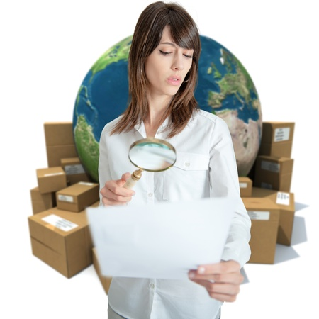 dubious: Young woman in a transportation background analyzing a document  Stock Photo