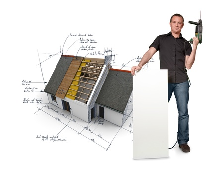 home renovation: Man with holding a power drill with a house with blueprints on the background