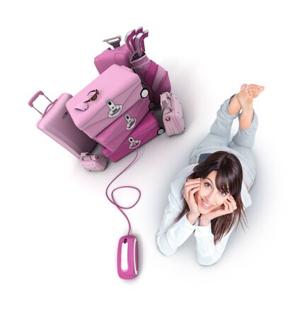 Young woman lying on the floor by a pile of luggage connected to a computer mouse photo