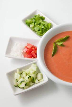 Gazpacho soup with side dishes photo