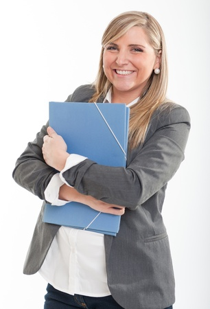 amused:  Amused cute young blond woman  in a casual vest carrying a folder  Stock Photo