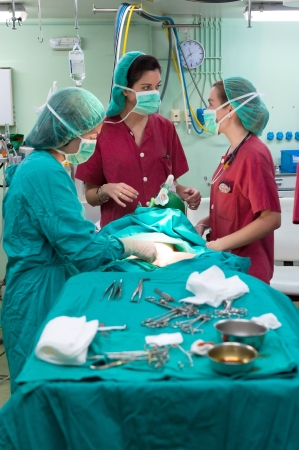 anesthetist: Medical team performing a pediatric surgery