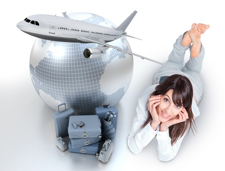 Young woman lying on the floor by a pile of luggage the Earth and a flying plane  photo