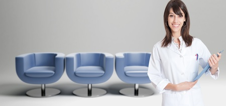 waiting room: Female healthcare worker and a row of chairs in the background Stock Photo