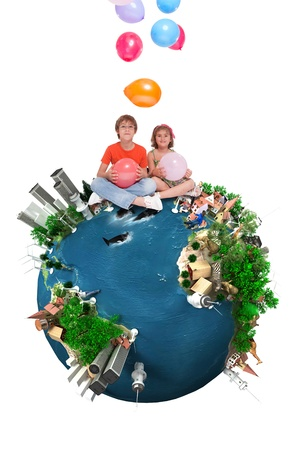 Kids sitting on top of a happy Earth throwing balloons  photo