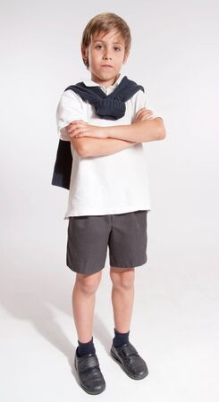 Schoolboy standing with his arms crossed Stock Photo