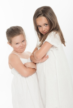 family fight: Two little sisters with angry expressions