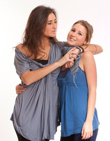 Young sisters one blond, the other brunette on an embrace