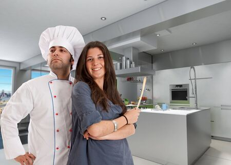 countertop:  Happy girl with a chef in a modern kitchen  Stock Photo