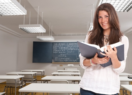 formulae:  Cute young woman in a mathematics classroom