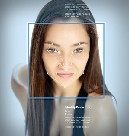 인식: 얼굴 인식 소프트웨어에서 선 여성의 얼굴 스톡 사진