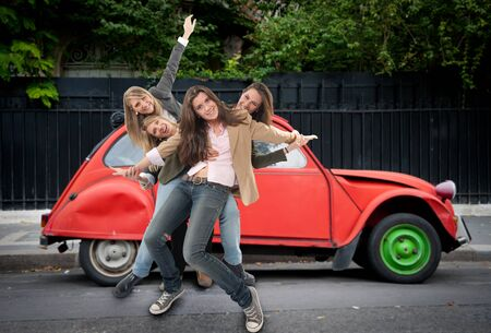 Group of young women having fun in the middle of the street photo