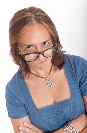 disappoint: Woman with an unhappy gesture wearing eyeglasses