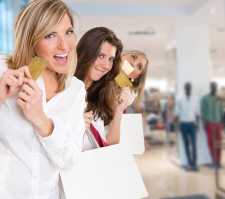 Three young women in a happy shopping expedition with credit cards photo