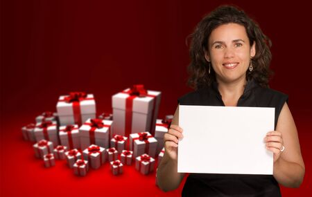 rd:  Brunette holding a blank paper with a background of gift boxes