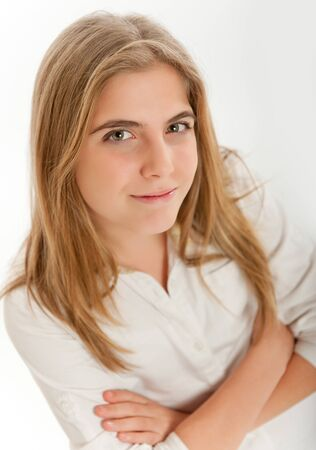 13:  Young blonde teenager smiling to the camera  Stock Photo