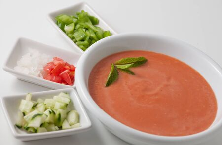 spanish culture: Gazpacho soup with side dishes Stock Photo