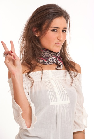 Young attractive brunette sticking out two fingers