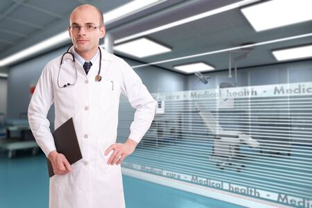 Serious looking doctor in a hospital interior  Stock Photo - 15895789