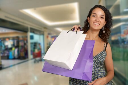 Happy exotic woman shopping at the mall Stock Photo - 15895815