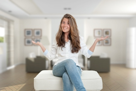 Happy young woman sitting at home photo