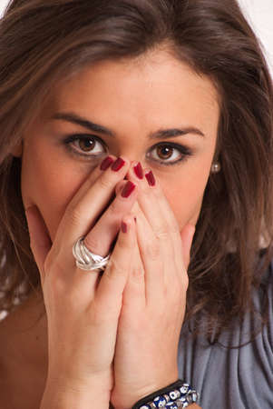 young brunette covering her face with her hands Stock Photo - 16007800