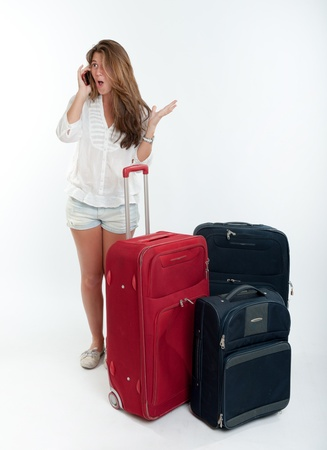 Young cute girl with luggage  talking on the phone Stock Photo - 15941613