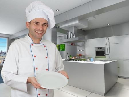 countertop:  Smiling chef holding an empty plate in a modern kitchen