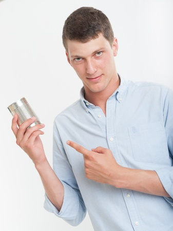 can food: Young man showing an aluminum can