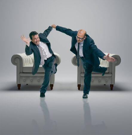 Humorous shot of a pair of running businessmen  photo