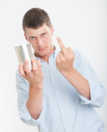 unlabelled: Young man holding an aluminum can and showing his middle finger Stock Photo