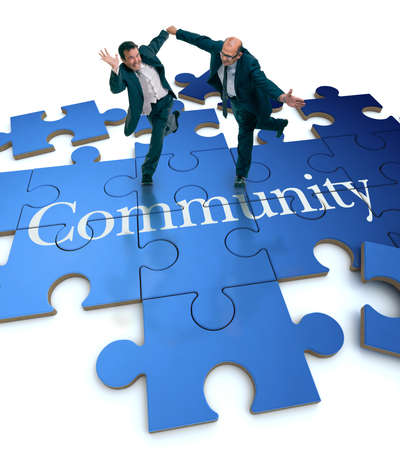 Humorous shot of a pair of running businessmen on a puzzle with the word Community photo
