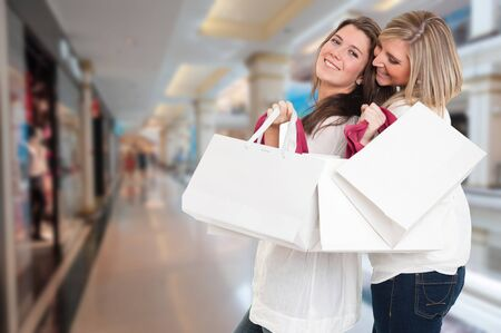 Two young women in a happy shopping expedition photo