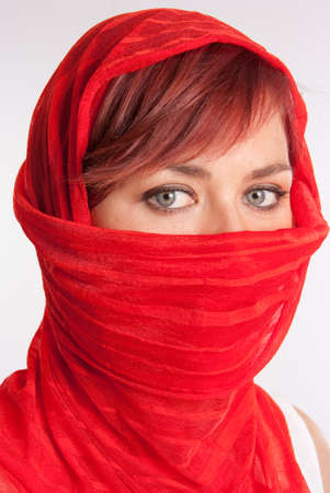 Pretty woman in a red veil photo