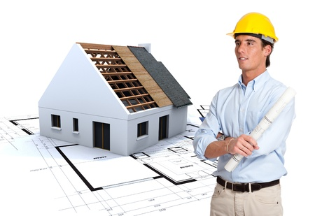 isolation:  Young architect looking to a house on construction with blueprints  Stock Photo