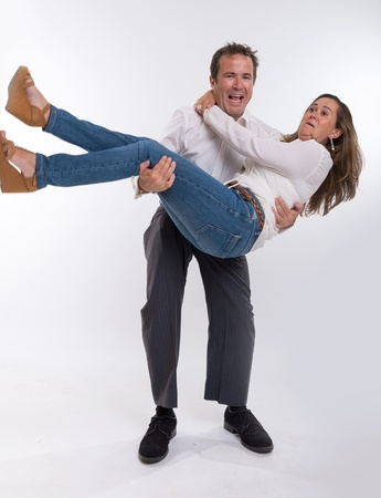 Man carrying his scared wife in his arms photo