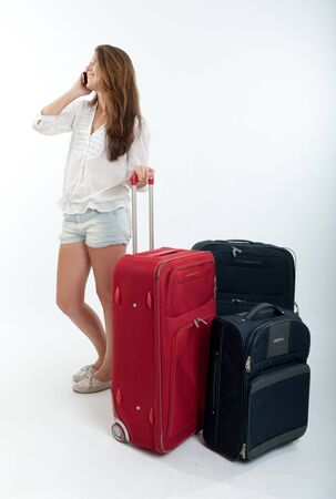 Young cute girl with luggage  talking on the phone  Stock Photo - 16087842
